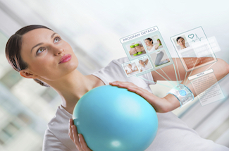 Portrait of modern healthy woman wearing smart watch device with touchscreen doing exercises